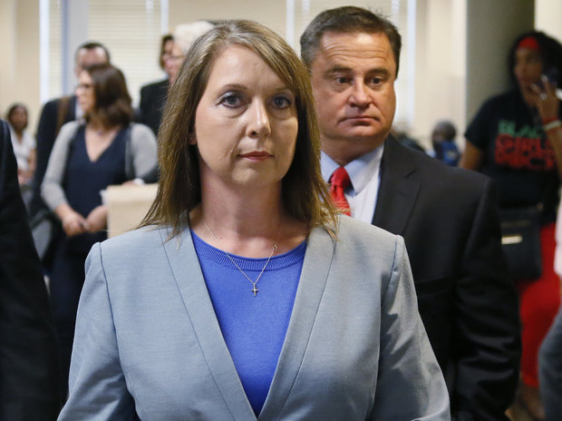 Betty Shelby leaves the courtroom with her husband, Dave Shelby, right, after the jury in her case began deliberations in Tulsa, Okla. on Wednesday, May 17, 2017.