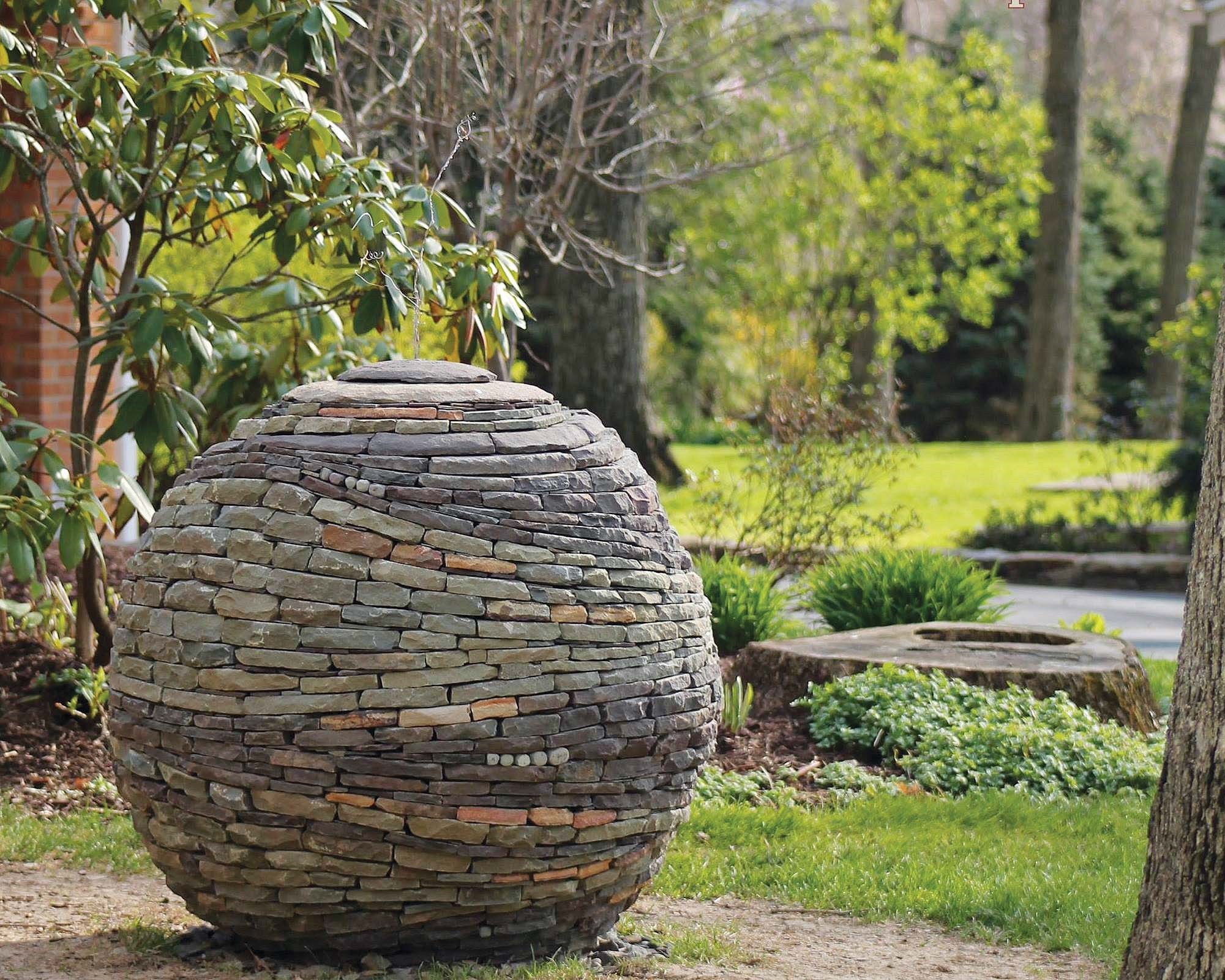 Stone Gardens Beachwood Ohio The use of stone in your garden gives it its bones all year round this amazing spherical stone creation was made by artist and stone mason devin devine in pennsylvaniajan johnsen the spirit of stone workwithnaturefo