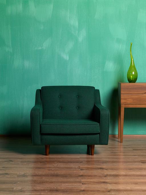 Retro Green Armchair On Wall
