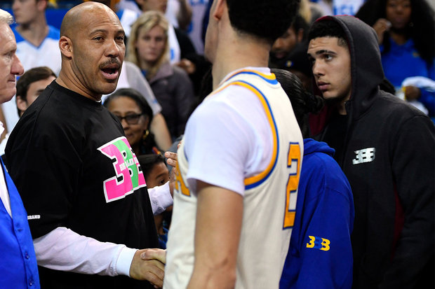 In this March 4, 2017, photo, UCLA guard Lonzo Ball, right, shakes hands with his father LaVar following an NCAA college basketball game against Washington State in Los Angeles. (AP Photo/Mark J. Terrill, File)