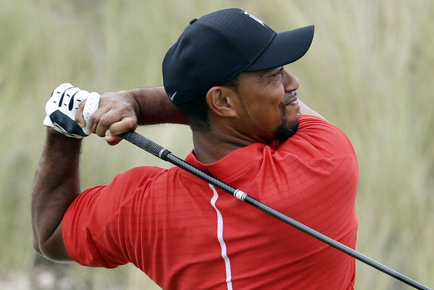 In this Dec. 4, 2016, photo, Tiger Woods watches his tee shot on the third hole during the final round at the Hero World Challenge golf tournament in Nassau, Bahamas. Police in Florida say Monday, May 29, 2017, that Woods has been arrested on DUI charges. (AP Photo/Lynne Sladky, File)