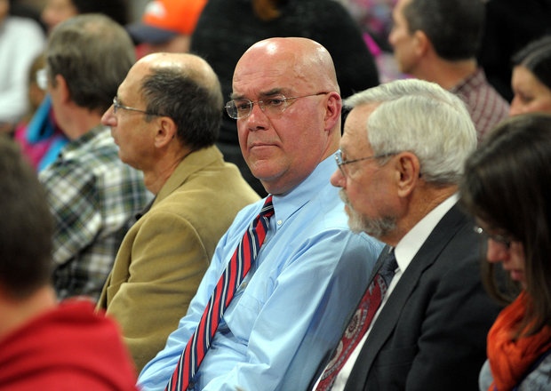 Substitute teacher Walter Tutka, center, sits during a Phillipsburg school board meeting in 2012 as he faced termination handing a Bible to a student. (Matt Smith | lehighvalleylive.com file photo)