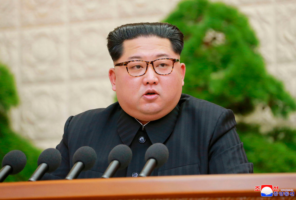 In this Friday, April 20, 2018, photo provided by the North Korean government, North Korean leader Kim Jong Un speaks during a meeting of the Central Committee of the Workers' Party of Korea,
