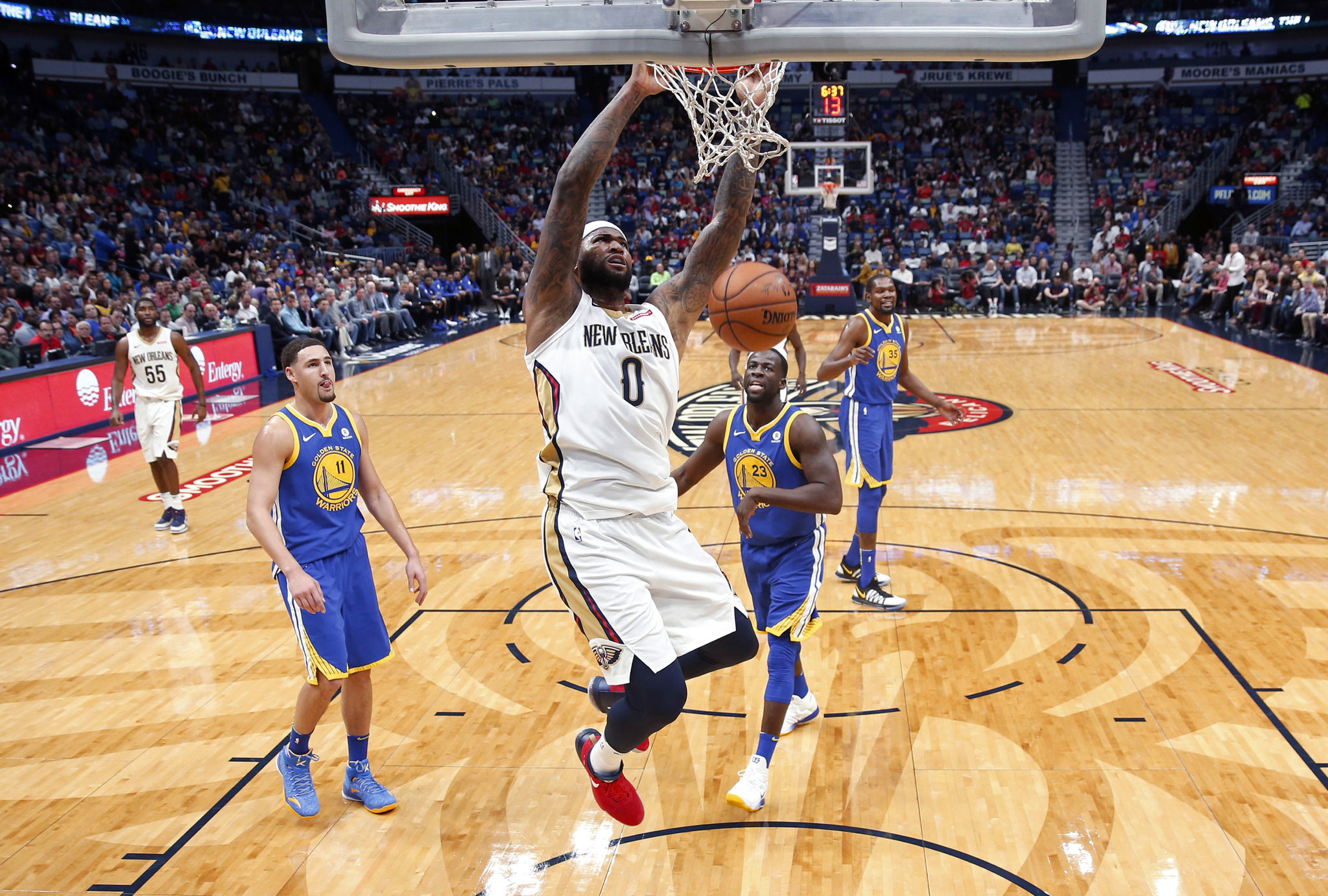 New Orleans Pelicans Center Demarcus Cousins (0) Dunks In Front