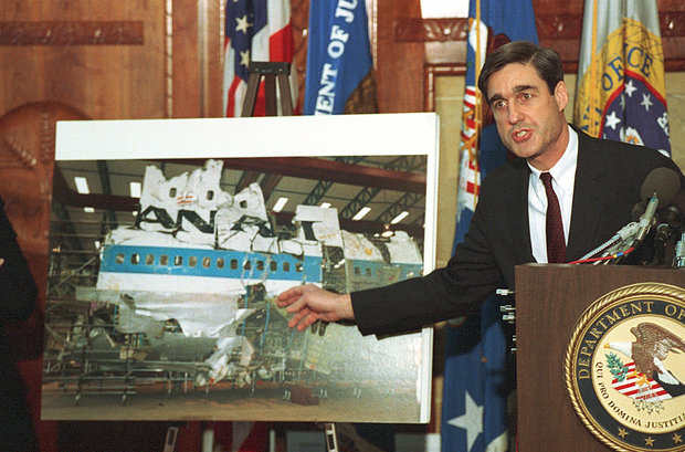 Then-Assistant Attorney General Robert Mueller points to a photo of the reconstructed wreckage of Pan Am Flight 103, which exploded over Lockerbie Scotland in 1988, killing 270 people on November 1, 1991.