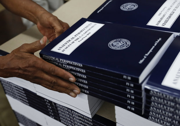 "In this photo taken May 19, 2017, a GPO worker stacks copies of ""Analytical Perspectives Budget of the U.S. Government Fiscal Year 2018"" onto a pallet at the U.S. Government Publishing Office's (GPO) plant in Washington. (Carolyn Kaster, Associated Press)"