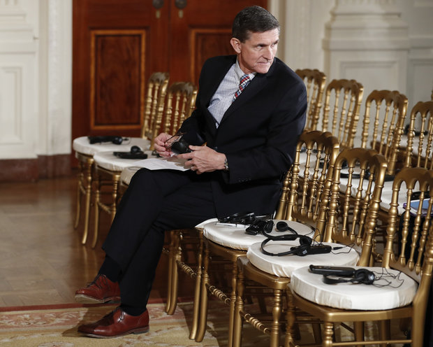 Then-National Security Adviser Michael Flynn sits in the front row in the East Room of the White House, in Washington on February 10, 2017. (Carolyn Kaster / AP)